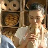 Female baker checks quality of bread